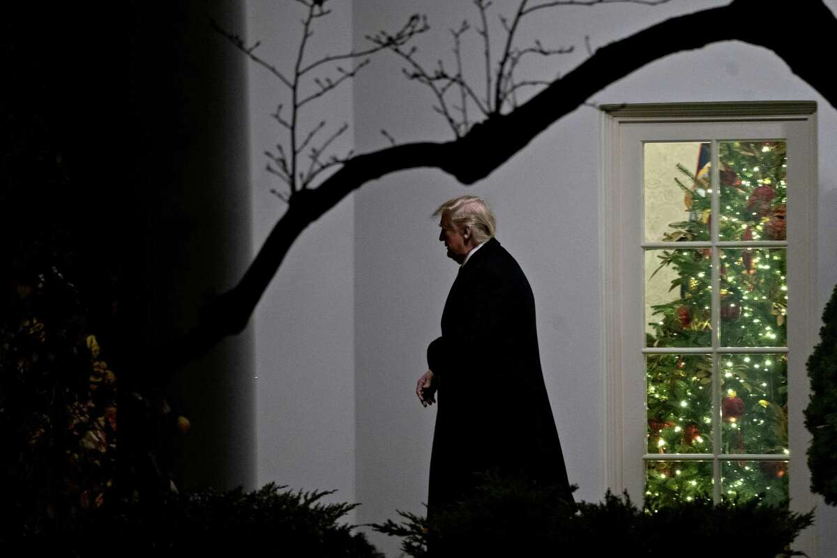 U.S. President Donald Trump exits the Oval Office of the White House before boarding Marine One in Washington, D.C., U.S., on Tuesday, Dec. 10, 2019. House Democrats delivered two tightly crafted articles of impeachment against Trump today that urged his removal as president for abusing the power of his office and keeping Congress from exercising its duty as a check on the executive branch. Photographer: Andrew Harrer/Bloomberg
