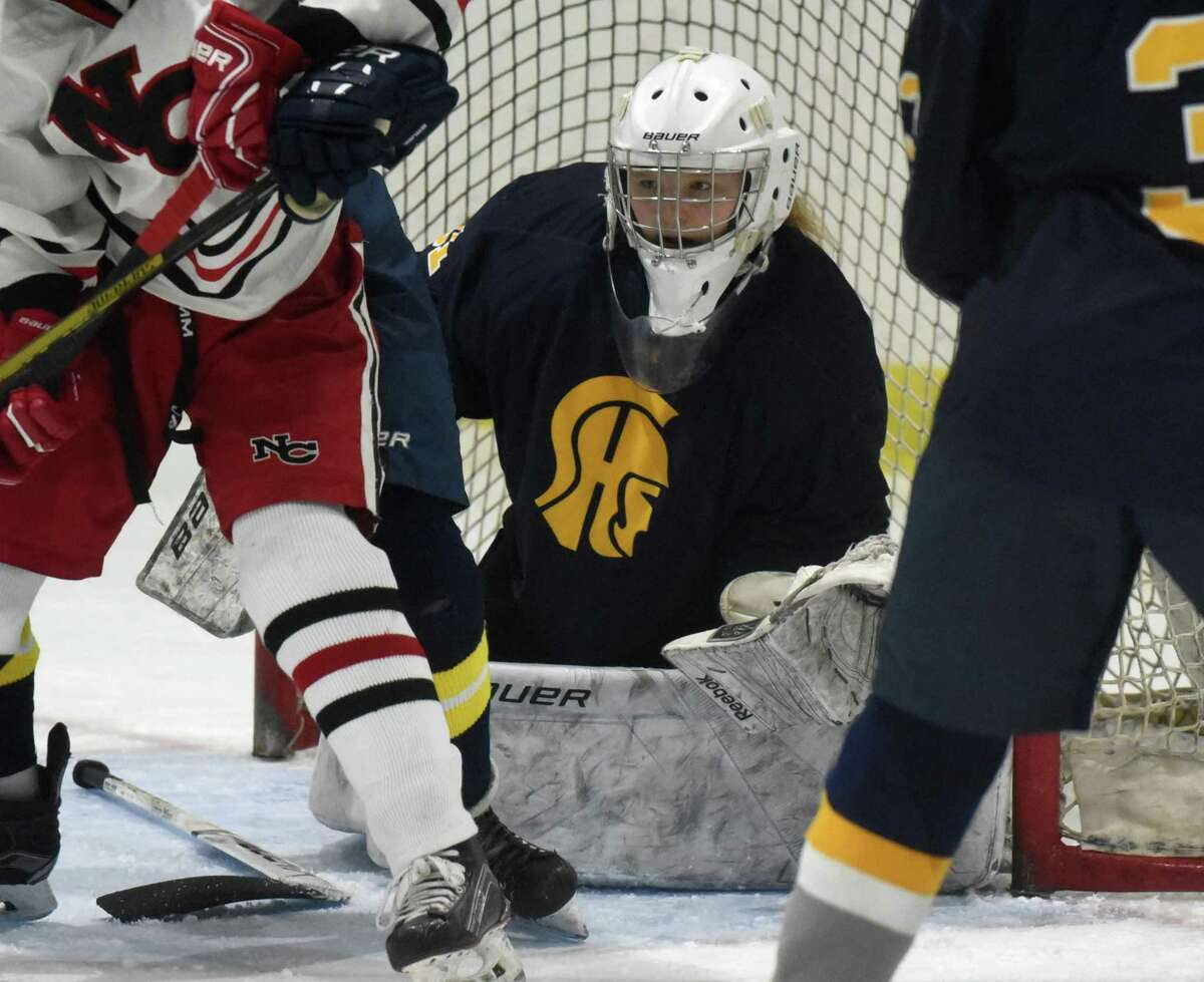 Simsbury goalie Kaitlyn O'Brien keeps her eyes on the puck during a game against New Canaan at the Darien Ice House in December.