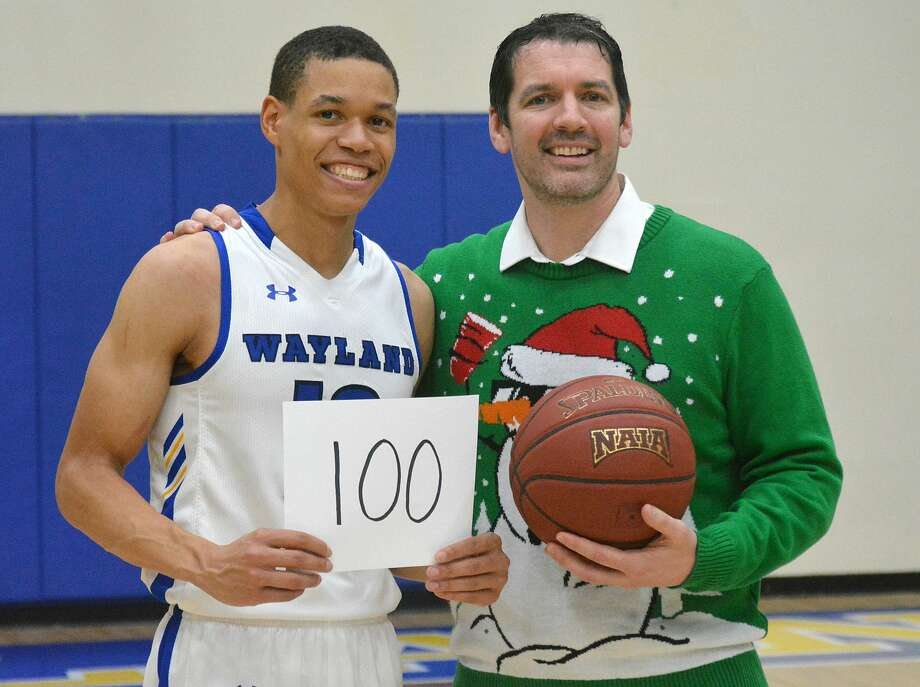 Senior J.J. Culver is presented the game ball by head coach Ty Harrelson after finishing with 100 points in ninth-ranked Wayland Baptist's 124-60 victory over Southwestern Adventist on Tuesday night in the Hutcherson Center. Photo: Nathan Giese/Planview Herald
