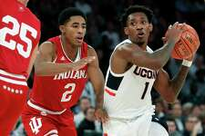 Connecticut guard Christian Vital (1) looks to pass with Indiana guard Armaan Franklin (2) defending during the first half of an NCAA college basketball game in the Jimmy V Classic, Tuesday, Dec. 10, 2019, in New York. (AP Photo/Kathy Willens)