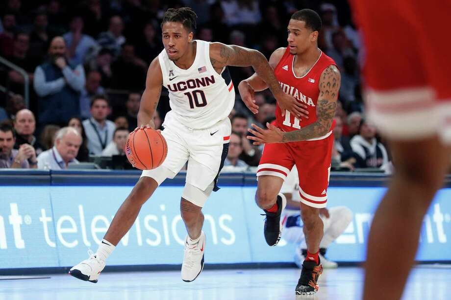 Connecticut guard Brendan Adams (10) pushes Indiana guard Devonte Green (11) away during the first half of an NCAA college basketball game in the Jimmy V Classic, Tuesday, Dec. 10, 2019, in New York. (AP Photo/Kathy Willens) Photo: Kathy Willens / Associated Press / Copyright 2019 The Associated Press. All rights reserved.