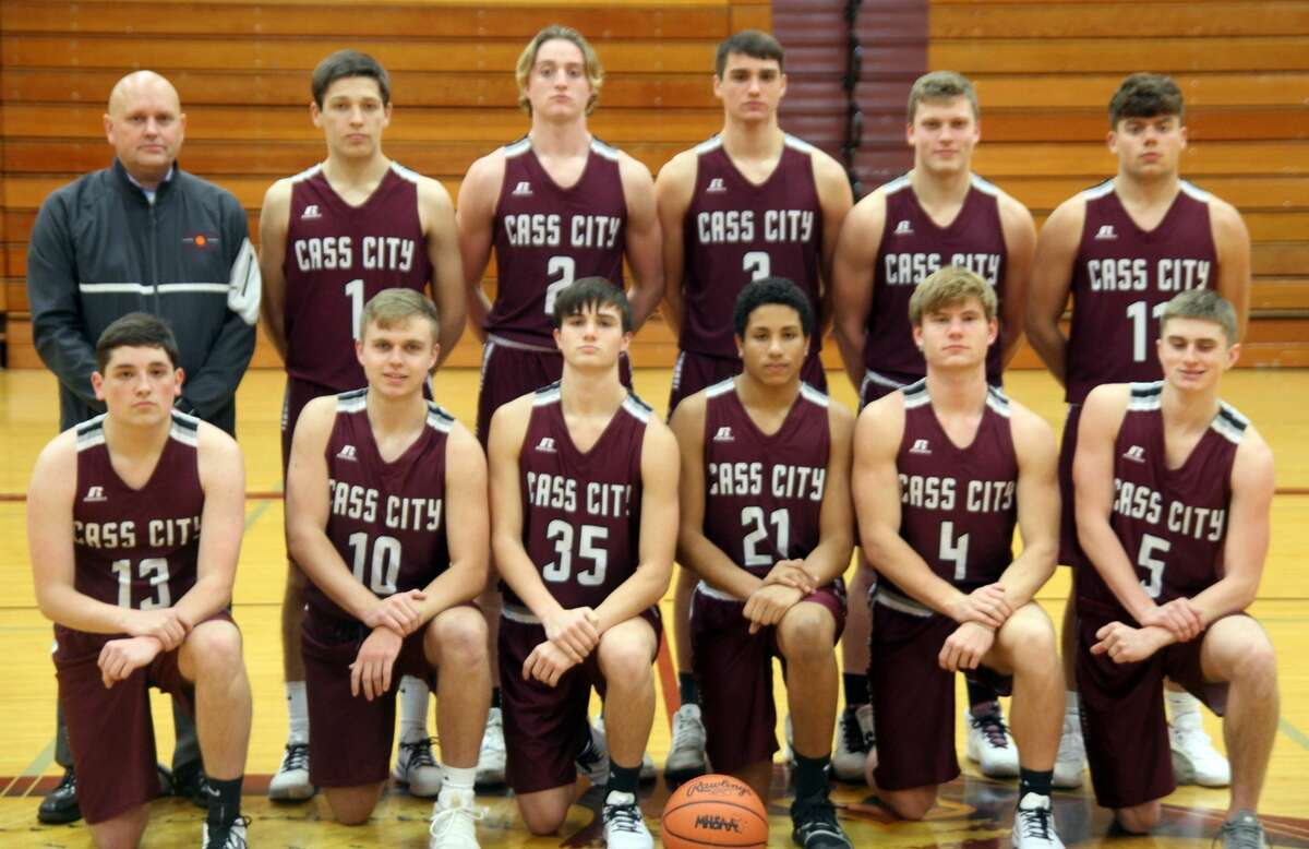 The Cass City boys basketball team is, front row, head coach Aaron Fernald, Tyler Czekal, Kenton Wiseman, Brandon Witherspoon, Jeremy Velasquez, Hadyn Horne and Bryce Fernland; back row, Kendall Amthes, Thom Rijshouwer, Landon Schenk, Alex Perry and Collen Wrubel.