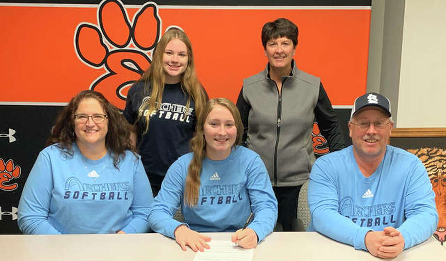 Edwardsville High School senior Lizzie Lebro, seated center, will play softball at St. Louis Community College. She is joined in the picture by her family and EHS coach Lori Blade. Photo: Matt Kamp|The Intelligencer