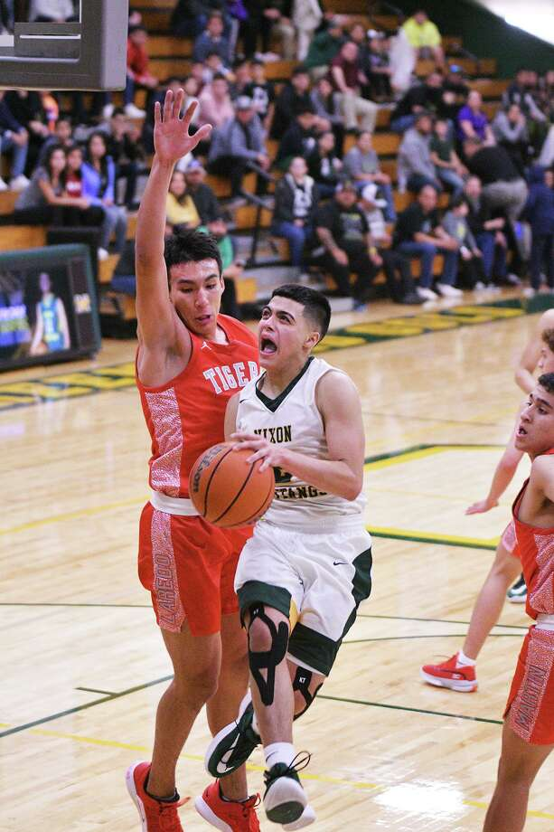 Nixon's LJ Herrera scored 11 points in the Mustangs' win over Martin Tuesday. Photo: Cuate Santos /Laredo Morning Times / Laredo Morning Times