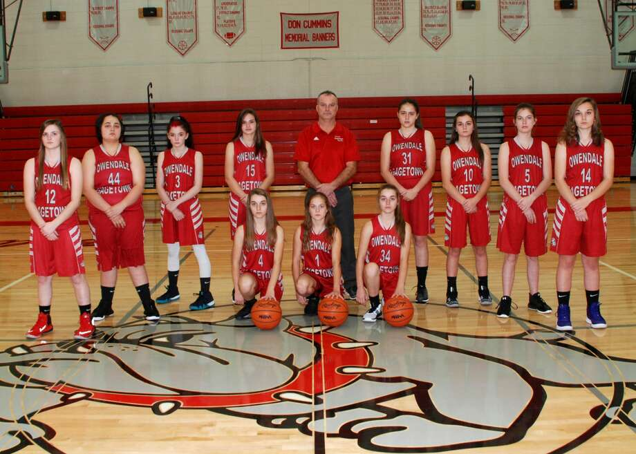 The Owen-Gage 2019 girls basketball team is, front row, Amber Haldane, Libby Ondrajka and Allison Haldane; back row, Kaitlyn LaCroix, Dana Morrish, McKayla Christian, Karsyn Gruehn, Coach Bob Haldane, Erin Morrish, Madelyn Haldane, Cristal Crandall, and Carley Haldane. Photo: Julie Warack/Ownedale-Gagetown Schools