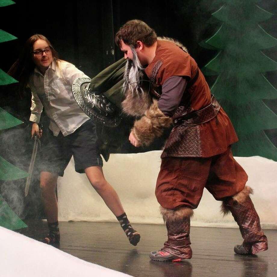 Nora Pasche and Ryan Willsey rehearse the final battle scene. (Photo/Robert Myers)
