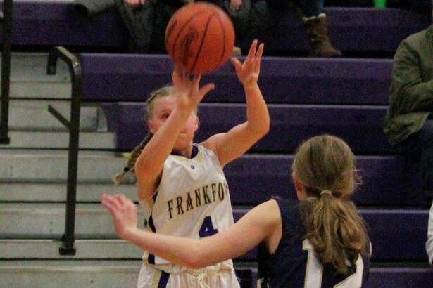 Kinzee Stockdale fires a jumper from the corner. (Photo/Robert Myers)