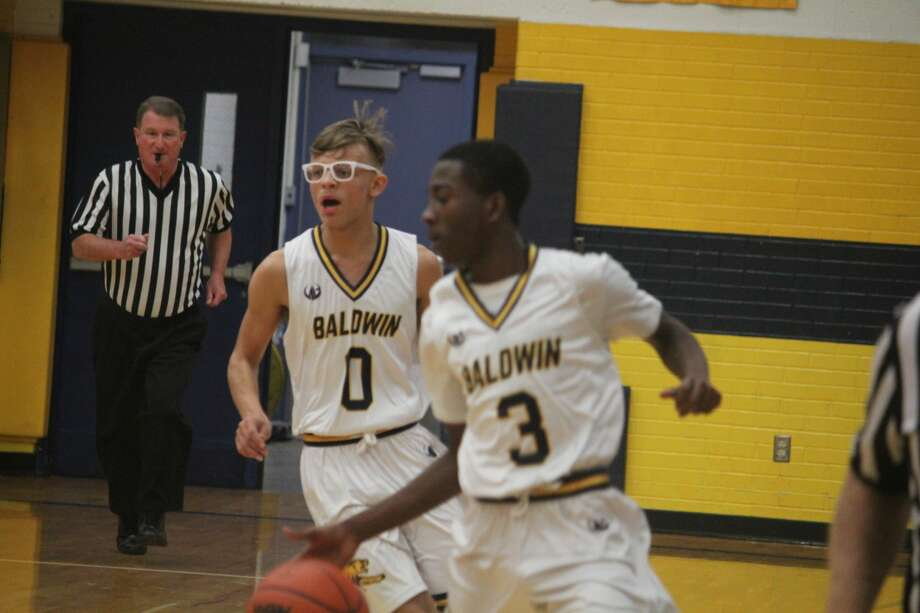Baldwin boys open their season with a win over Traverse City Christian Photo: John Raffel
