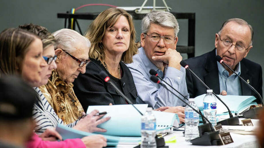From left, newly appointed Lewis and Clark Community College Interim President Lori Artis speaks as Student Trustee April Tulgetske and Trustees Charles Hanfelder, Julie Johnson, Kevin Rust and David Heyen listen Tuesday night. Photo: Nathan Woodside | The Telegraph