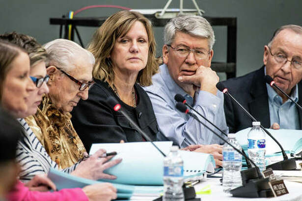 From left, newly appointed Lewis and Clark Community College Interim President Lori Artis speaks as Student Trustee April Tulgetske and Trustees Charles Hanfelder, Julie Johnson, Kevin Rust and David Heyen listen Tuesday night.