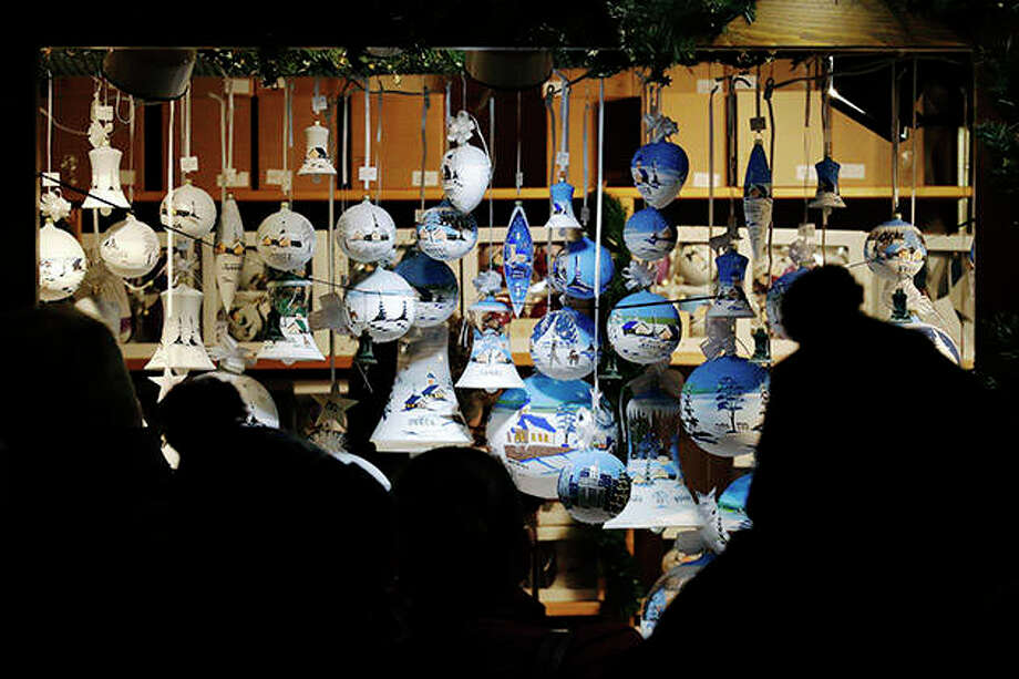 People shop for original German glass Christmas ornaments at the Christkindlmarket in downtown Chicago. Inspired by the Christkindlesmarkt in Nuremberg, Germany, which began in 1545, the Christkindlmarket Chicago brings a cherished German and European tradition to the city. Photo: Nam Y. Huh | AP
