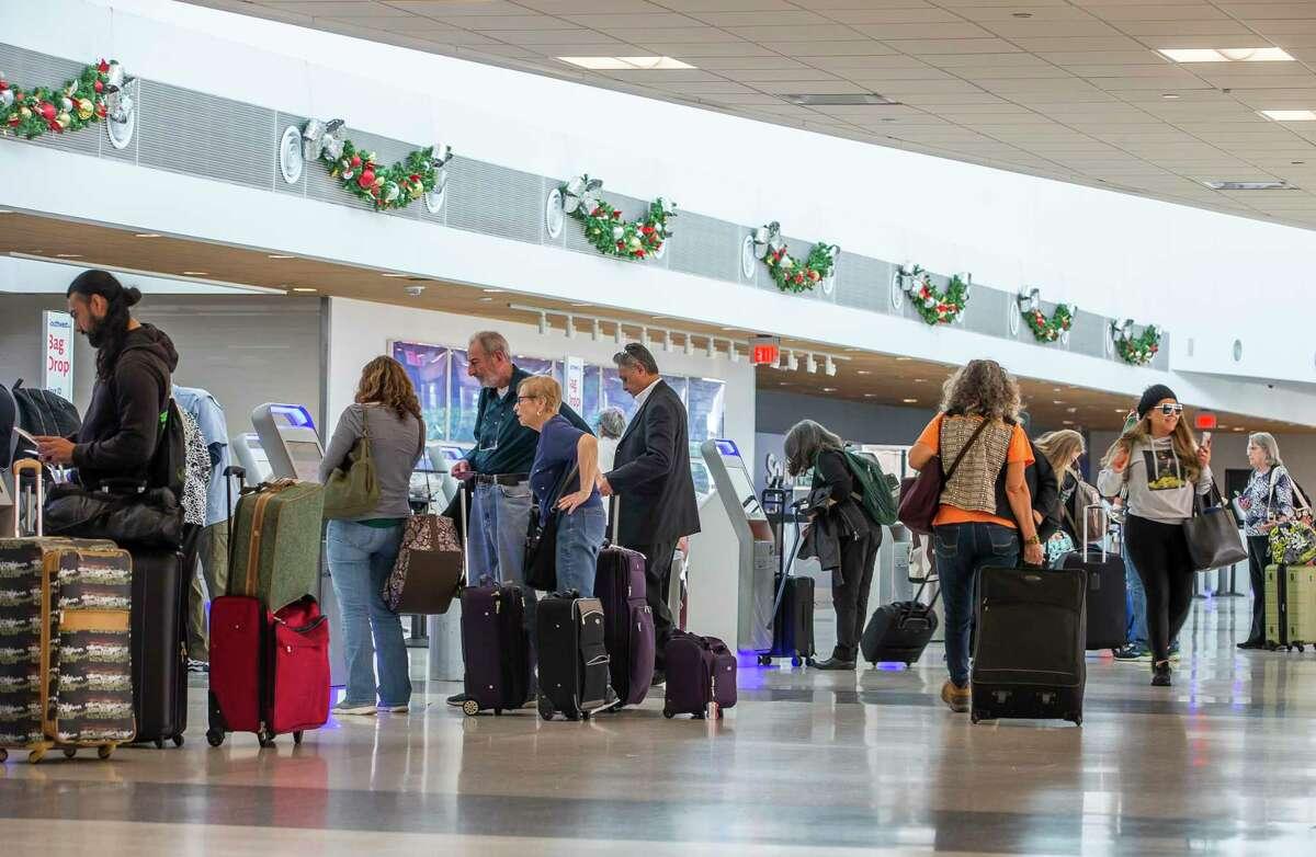 Travelers move through Hobby Airport in Houston, Monday, Dec. 9, 2019.