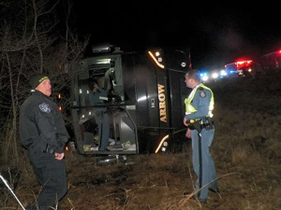 Four passengers were hurt when their charter bus from Schenectady rolled over on Interstate 95 late Tuesday in Maine.