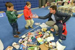 Brothers Greg and Blake Vasse learn about recycling with father Greg during last year's Zero Waste Faire presented by Wilton Go Green.