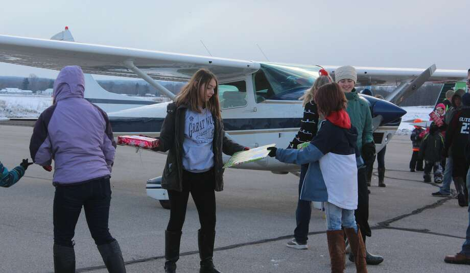 Over the weekend, volunteers unloaded more than 30 planes atRoben-HoodAirport as part of Operation Good Cheer. The event is an annual holiday program that helps bring Christmas presents to foster children across the state. Photo: Pioneer Photo/Catherine Sweeney