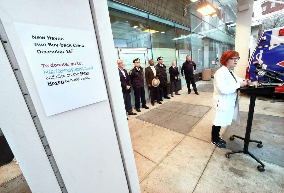 A press conference in an ambulance bay at Yale New Haven Hospital concerning a gun buyback on Dec. 12, 2017. Photo: File Photo / New Haven Register