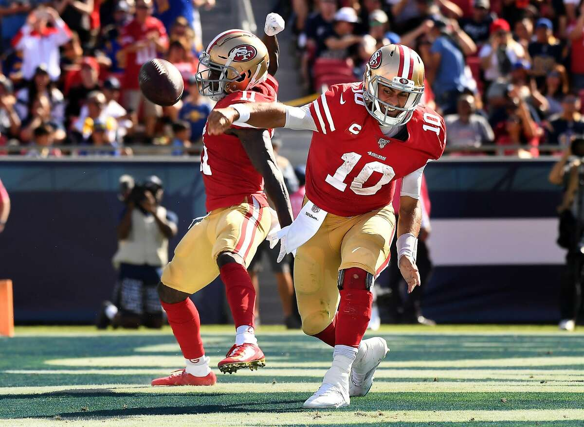 San Francisco 49ers quarterback Jimmy Garoppolo (10) spikes the ball after scoring a touchdown against the Rams in the 3rd quarter at the Coliseum on Oct. 13, 2019. (Wally Skalij/Los Angeles Times/TNS)