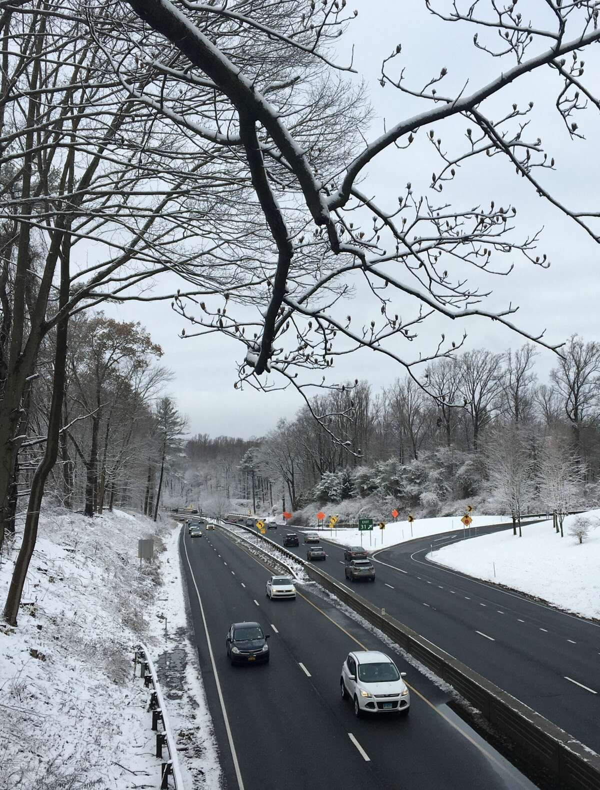 Snow along the Merritt Parkway on Wednesday, Dec. 11, 2019, in Greenwich, Connecticut.