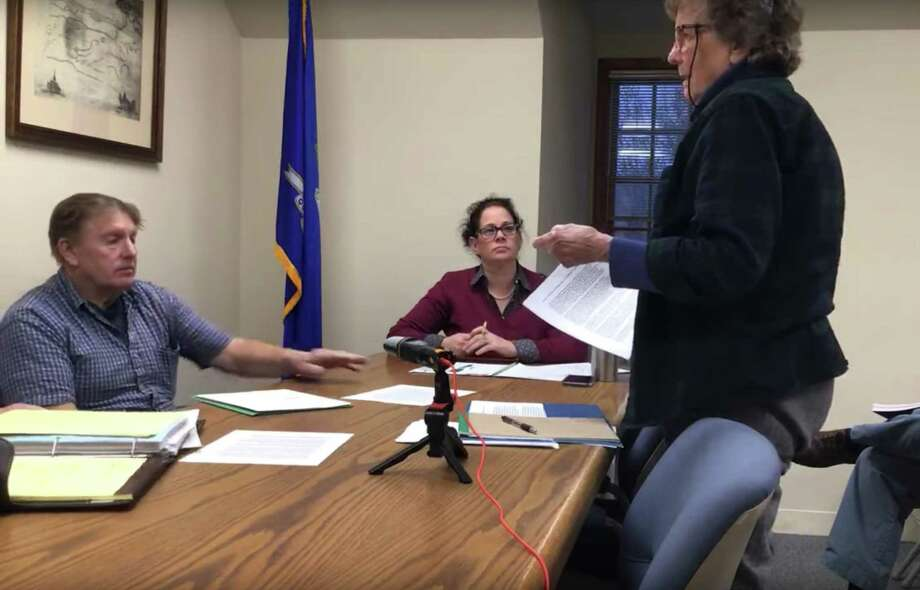 Selectman Ed Matson, left, First Selectman Jean Speck, center, and Kent Affordable Housing president Virginia Bush Suttman, right, at the Board of Selectmen's special meeting on Dec. 5, 2019. Photo: Town Of Kent / YouTube