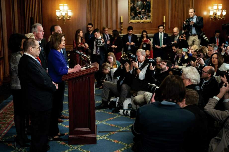 House Speaker Nancy Pelosi (D-Calif.) and leaders of several key congressional committees announce articles of impeachment against President Donald Trump on Tuesday. Photo: Erin Schaff /New York Times / NYTNS