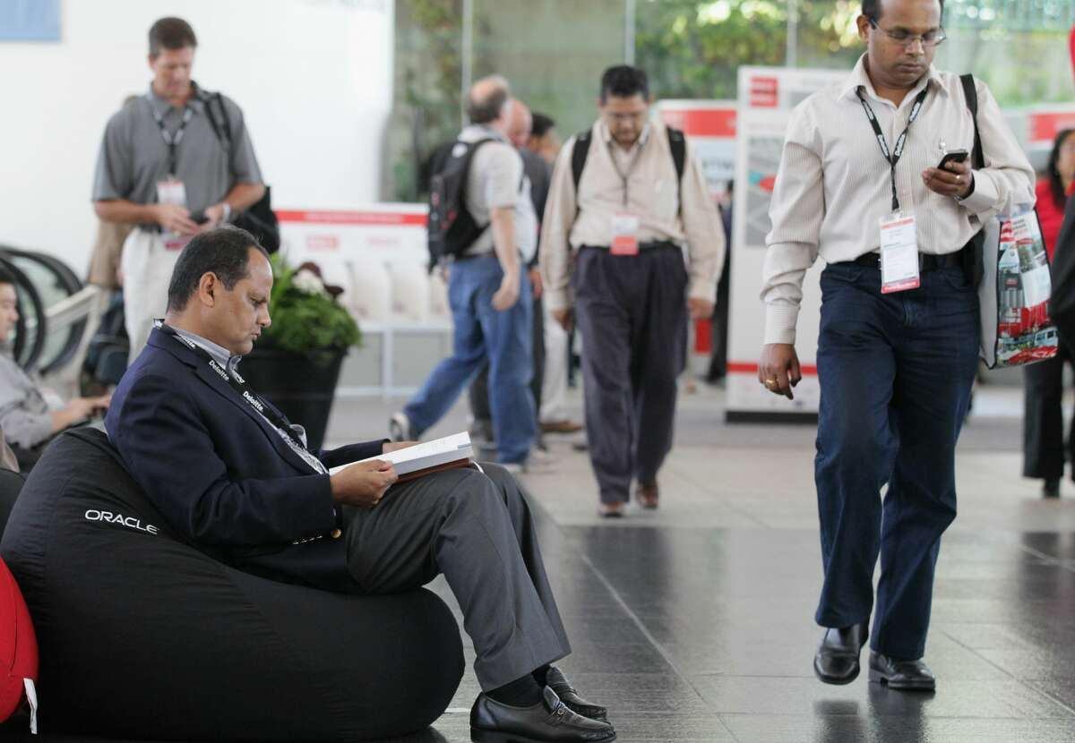 An Oracle Open World attendee sits on a bean bag as he reads the newspaper at the 2010 Oracle Open World conference at the Moscone Center on September 21, 2010 in San Francisco.