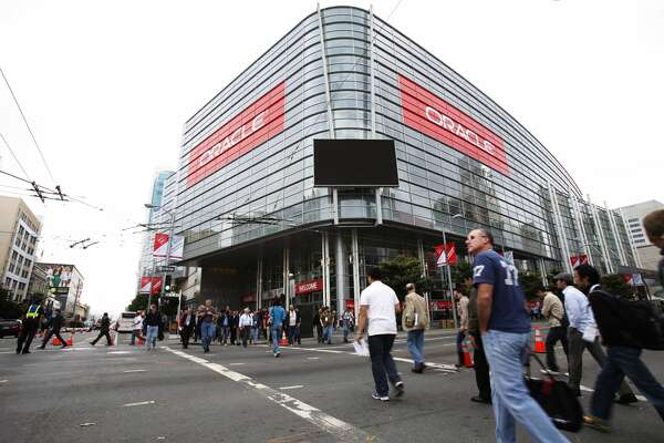 Attendees walks outside Moscone Center during the annual Oracle OpenWorld Conference on October 2, 2011 in San Francisco.