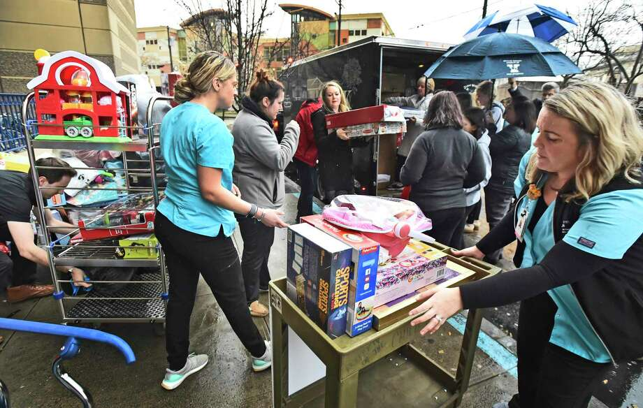 """New Haven, Connecticut - Tuesday, December 10, 2019: Yale New Haven Hospital volunteers and friends of """"Faith's Toy Drive"""" of Shelton unload a trailer load of approximately 2100 toys to Yale New Haven Hospital in New Haven Tuesday afternoon for distribution by the YNHCH Auxiliary Toy Closet and the Child Life department. It it's third year, the annual toy drive was started by Faith Tremblay of Shelton, now 16, and her mother Lisa Tremblay. Photo: Peter Hvizdak / Hearst Connecticut Media / New Haven Register"""