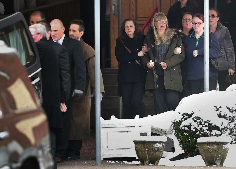 Family members of homicide victim Christine Holloway, of Ansonia, follow behind the casket following funeral services at St. Andrew Catholic Church on Anton Street in Bridgeport, Conn. on Wednesday, December 11, 2019. Photo: Brian A. Pounds / Hearst Connecticut Media / Connecticut Post