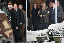 Family members of homicide victim Christine Holloway, of Ansonia, follow behind the casket following funeral services at St. Andrew Catholic Church on Anton Street in Bridgeport, Conn. on Wednesday, December 11, 2019.
