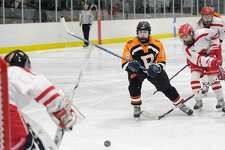 Emily Stefanelli takes a backhand shot in a game against Greenwich last season.