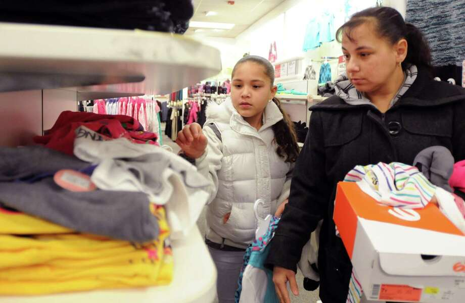 "Jennica Gutierrez of East Haven, 10, picks out clothing for herself while shopping with her mother at the Kohl's department store in Branford during the East Haven Rotary Club's 12th annual ""Clothe the Children"" campaign in 2012. Photo: Hearst Connecticut Media File / PETER HVIZDAK"