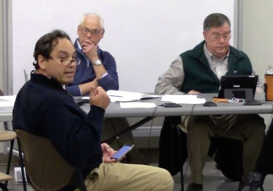 Darien resident Perry Boyle is making a point at the most recent Pear Tree Point Beach Building Committee meeting. Photo: Darien TV79 / Connecticut Post