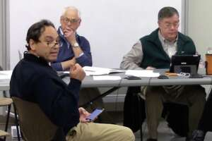 Darien resident Perry Boyle is making a point at the most recent Pear Tree Point Beach Building Committee meeting.