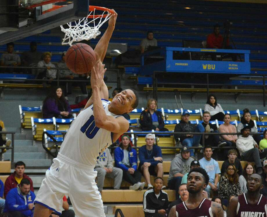Senior J.J. Culver slams home two of his 100 points during the ninth-ranked Wayland Baptist men's basketball team's 124-60 victory over Southwestern Adventist on Tuesday, Dec. 10 in the Hutcherson Center. Photo: Nathan Giese/Planview Herald