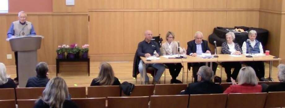 At Home in Darien recently held its annual meeting. A five-member panel shared information and answered questions. Darien resident and volunteer Peter Eder moderated the event. Photo: Darien TV79 / / Connecticut Post