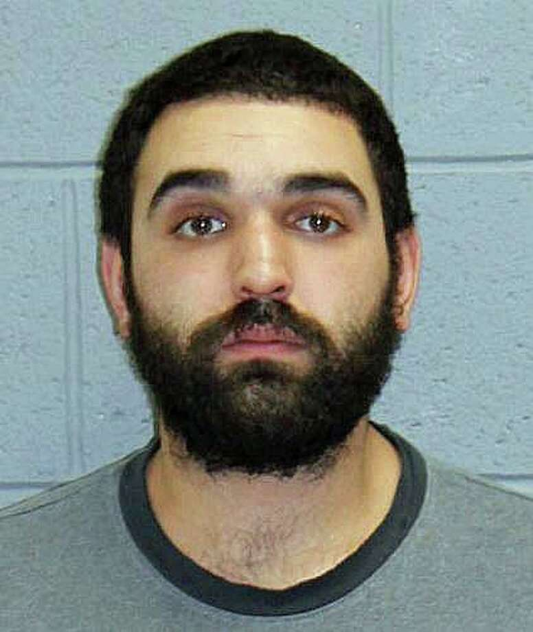A 25-year-old Naugatuck man is accused of killing his girlfriend's cat. Christopher Monteleone was charged with cruelty to animals and held on a $100,000 bond. Officers located physical evidence, including the remains of the cat which substantiated the victim's allegation that the cat had been killed by Monteleone. Photo: Naugatuck Police Photo