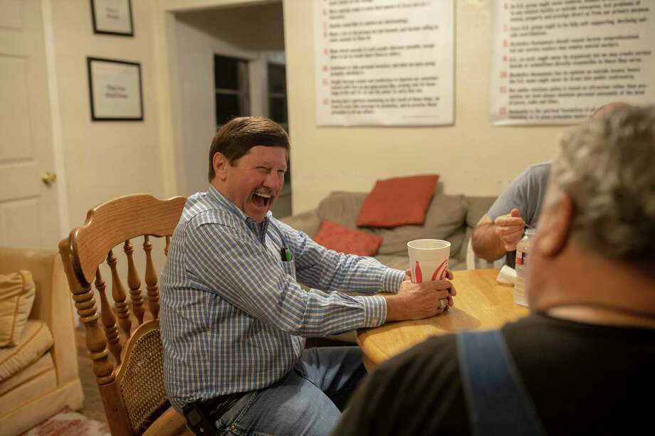 Retired Conroe business man, Chuck Bergfeld, laughs while sharing stories with residents of Bonnie's House during a late evening, Thursday, Dec. 5, 2019. Bergfeld continues to support through donations to Bonnie's House. Photo: Gustavo Huerta, Houston Chronicle / Staff Photographer / Houston Chronicle