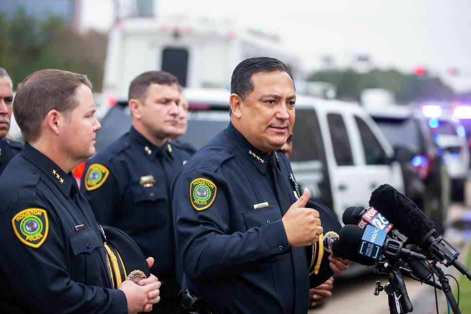 In this Monday, Dec. 9, 2019 photo, Houston Police Chief Art Acevedo speaks to the media before officers from the Houston Police Department escort the body of Sgt. Christopher Brewster out of the Harris County Institute of Forensic Sciences building in Houston. During the a news conference Acevedo called on GOP U.S. senators, including John Cornyn from Texas, to renew the Violence Against Women Act. (Mulligan/Houston Chronicle via AP)