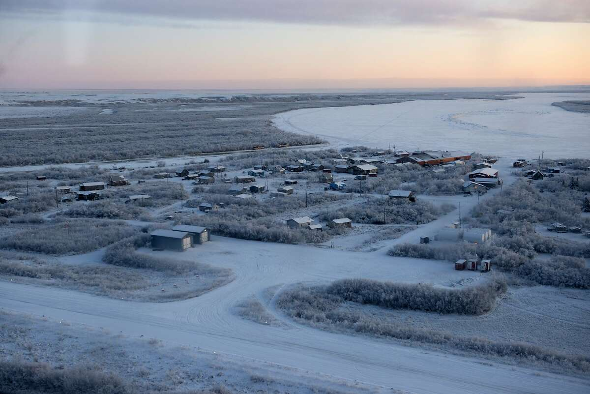 This Dec. 3, 2019 photo provided by the U.S. Air Force/Alaska National Guard shows the village of Napakiak one location of this year's Operation Santa Claus. The Alaska National Guard brought its Operation Santa Claus to the western Alaska community, which is being severely eroded by the nearby Kuskokwim River.