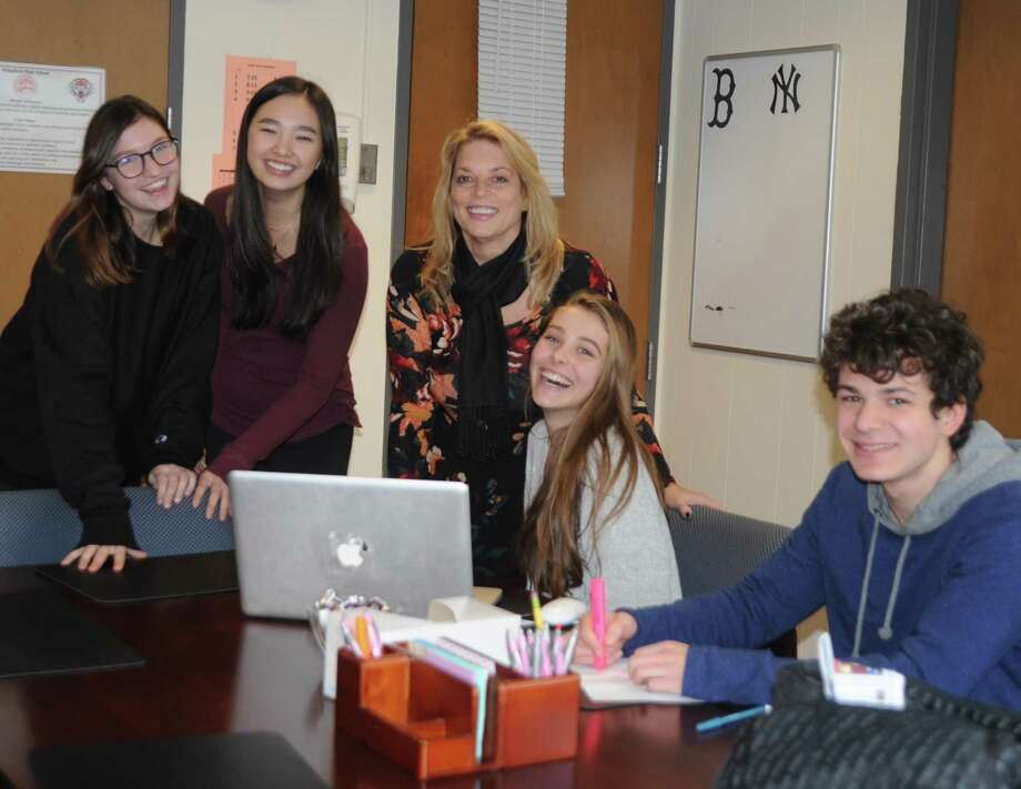 Working with kids is what Dr. Stacey Gross says she'll miss most about being Ridgefield High School principal. From left are: Evie Langston, Camryn Liem. Dr. Gross, Brooke Manganiello and James Hooker. Photo: Macklin Reid / Hearst Connecticut Media