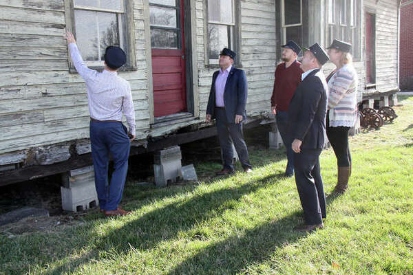 SJ Morrison, left, points out some of the features that will be replaced on the Nickel Plate Station Thursday if the group's funding goals are achieved. They hope to raise $100,000. With Morrison are some of his Board of Conductors - John McDole, Paul Abert, Abigail Schwent and Matt Cundiff.
