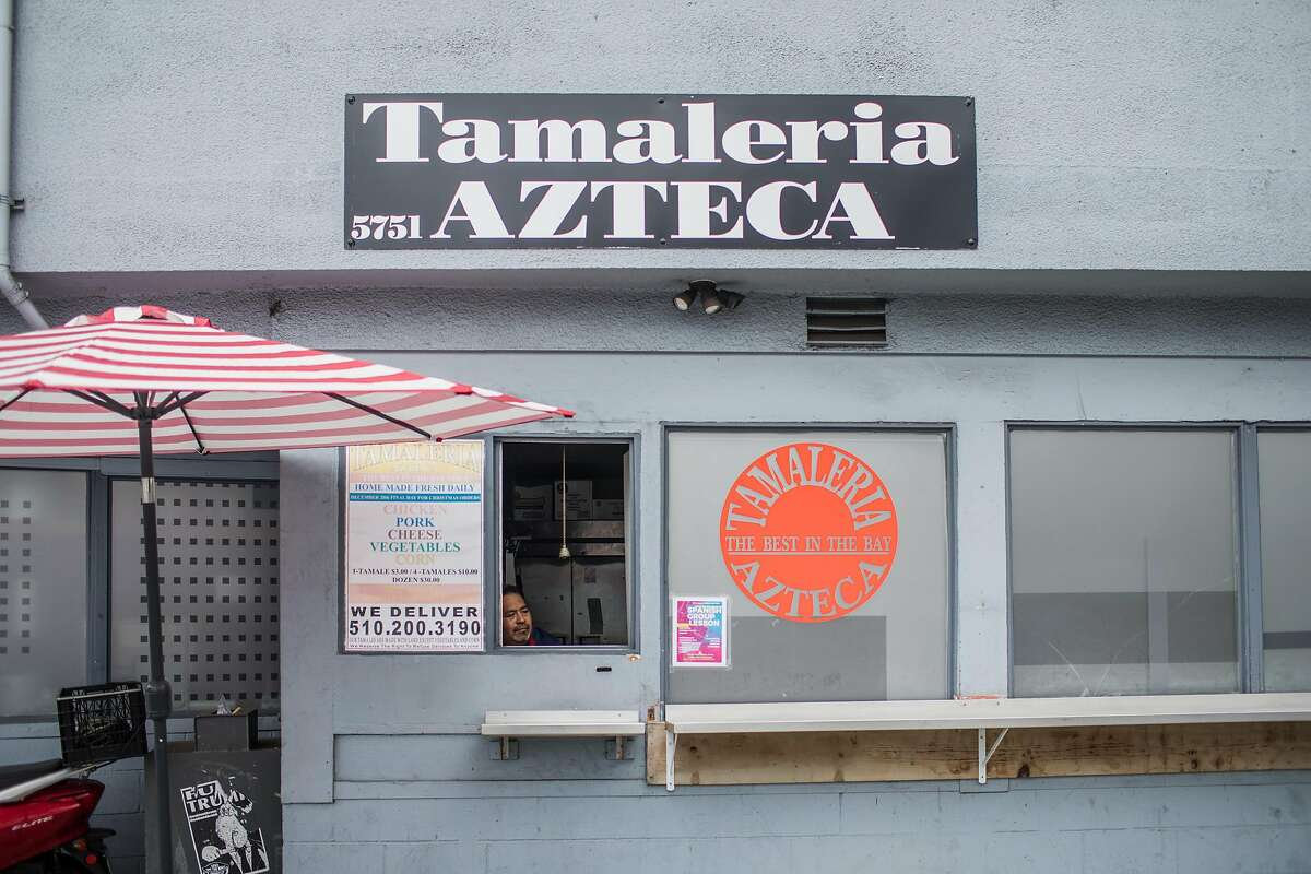 Owner Sergio Gomez waits for customers at the order window just after opening at Tamaleria Azteca in North Oakland on November 14, 2019.
