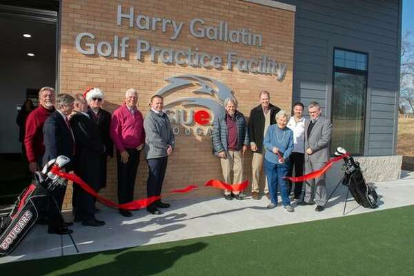 Bev Gallatin cuts the ribbon at the Harry Gallatin SIUE Golf Practice Facility inside the Sunset Hills Country Club in Edwardsville.