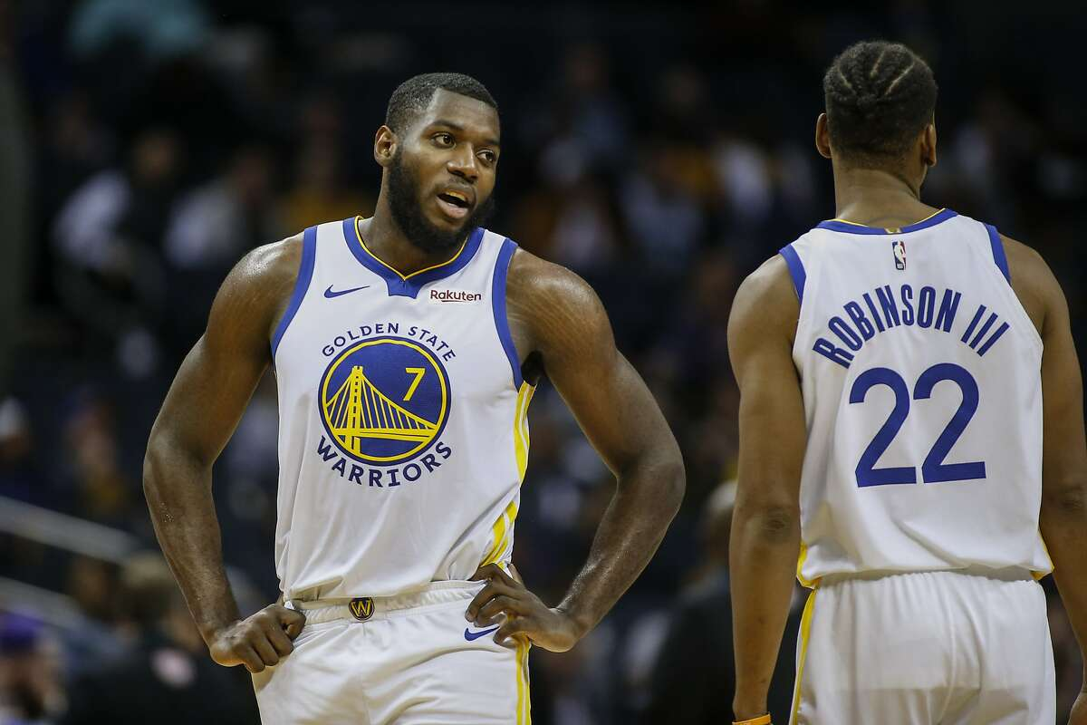 Golden State Warriors forward Eric Paschall, left, talks to teammate Glenn Robinson III during a timeout in the first half of an NBA basketball game against the Charlotte Hornets in Charlotte, N.C., Wednesday, Dec. 4, 2019. (AP Photo/Nell Redmond)
