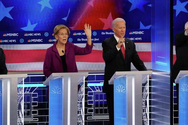 Mayor Pete Buttigieg, Sen. Elizabeth Warren, Vice President Joe Biden and Sen Bernie Sanders participate in a Democratic presidential debate in Atlanta, Nov. 20, 2019. In a nominating contest that will be heavily influenced by black voters, charter schools present a challenging issue for the four Democratic front-runners. (Ruth Fremson/The New York Times)