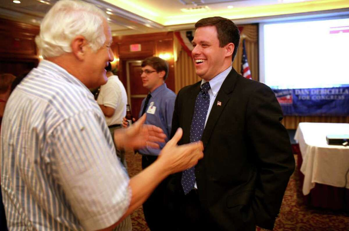 4th Congressional District Republican primary candidate Dan Debicella, right, greets supporter Ed Whitney of Westport at the Norwalk Inn on Tuesday night, August 10, 2010.