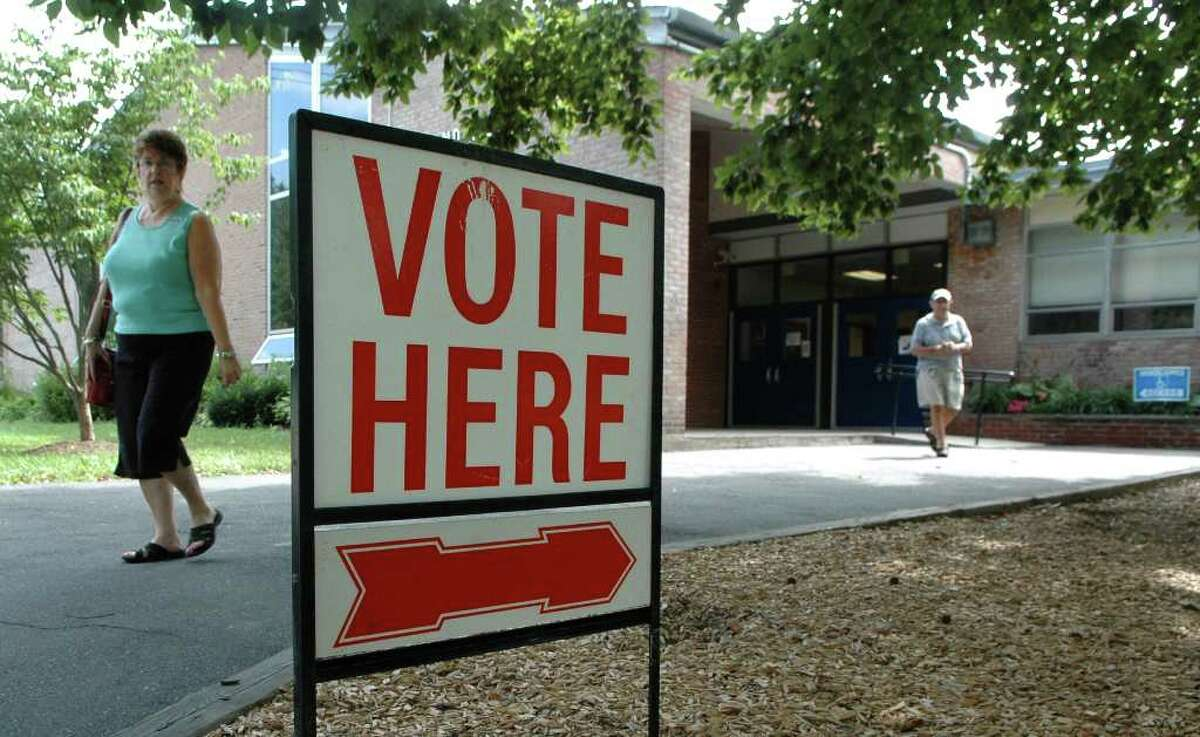 A slow trickle of voters arrive at Holland Hill School in Fairfield to cast their ballot for the candidate of their choice in the primary election on Tuesday August 10, 2010.