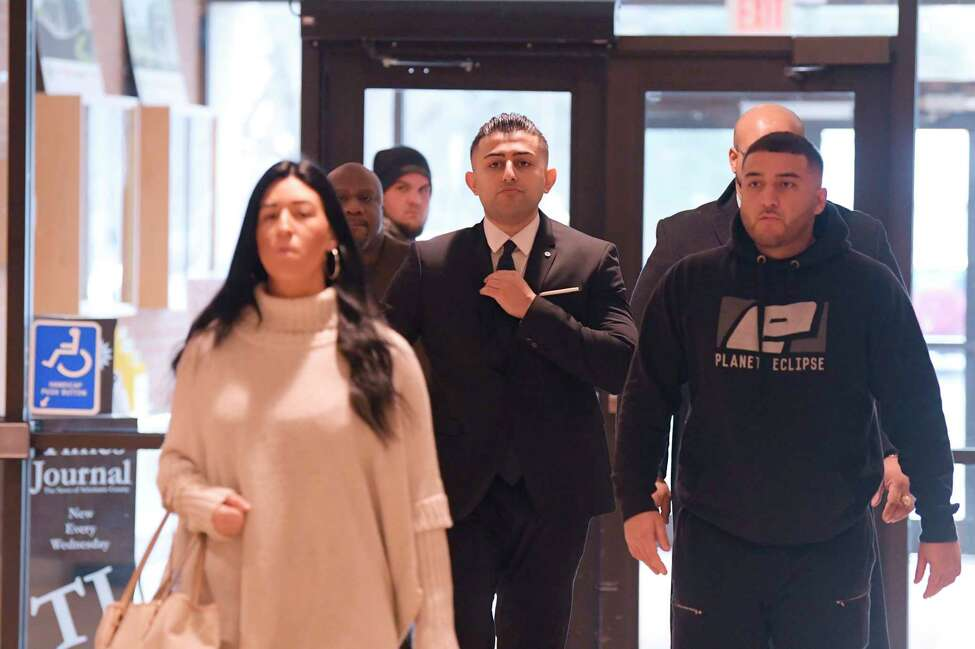 Nauman Hussain, center, walks into the Schoharie County Court for a pre-trial hearing on Tuesday, Dec. 11, 2019, in Schoharie, N.Y. Hussain is the operator of the company that owned the limousine that crashed in Schoharie County last year, killing 20 people. (Paul Buckowski/Times Union)
