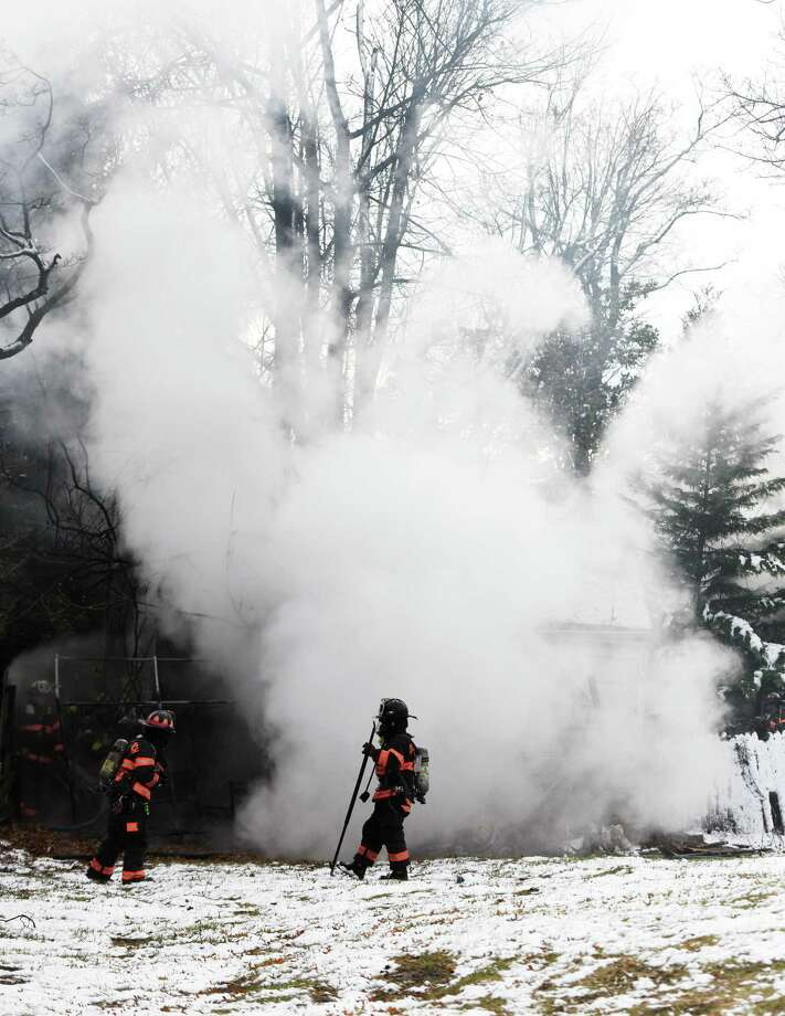 Greenwich firefighters respond to a two-car garage fire on Tomac Court in Old Greenwich, Conn. Wednesday, Dec. 11, 2019. The detached two-car garage was ablaze when firefighters arrived on scene and was extinguished in 19 minutes without any injuries or damage to adjoining structures. Photo: Tyler Sizemore / Hearst Connecticut Media / Greenwich Time