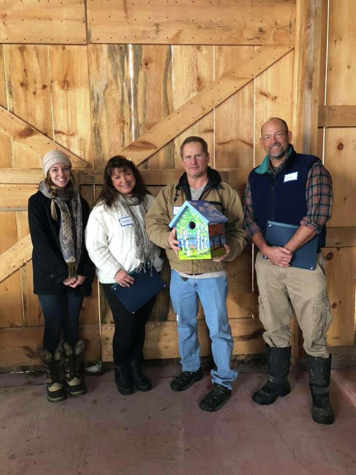 From left is Dana Kear (PLAN Program Associate) for Gail Grow, Deanna and Rob Hadley (for Dolores Arste and David Hickey) and Will Orthwein (PLAN Chair)at the PLAN's celebration of Conservation Heroes.